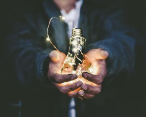 man-with-lightbulb-graphic-in-hand